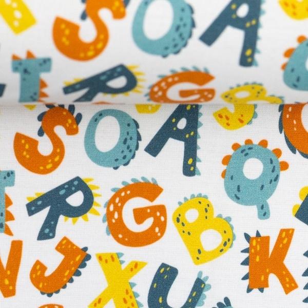 Baumwolle - Baumwoll Stoff - Swafing - Kim - Buchstaben im Drachendesign auf Hellsand Reststück 50cm
